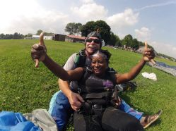 Sheri Hunter skydiving land thumbs up