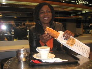 Angenette prepared to eat a very long sandwich.