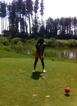 Sheri Hunter golfing