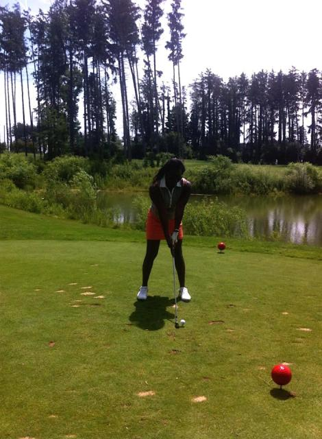 Sheri Hunter golfing