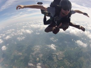 Angenette Lynch giving thumbs up after jumping from airplane.