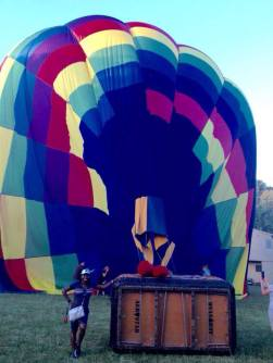 Sheri beside hot air ballon