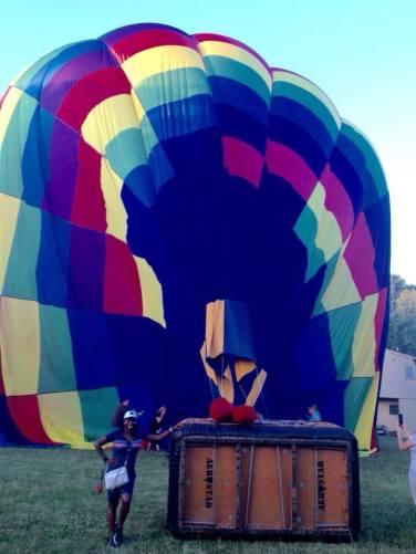 Sheri beside hot air ballon