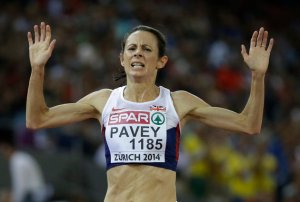 Britain's Jo Pavey crosses the line to win the gold medal in the women's 10,000m final during the European Athletics Championships in Zurich, Switzerland, Tuesday, Aug. 12, 2014. (AP Photo/Matt Dunham)