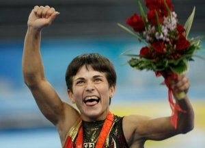 Germany's gymnast Oksana Chusovitina celebrates after winning the silver medal during the women's vault apparatus finals at the Beijing 2008 Olympics in Beijing, Sunday, Aug. 17, 2008. (AP Photo/Matt Dunham)